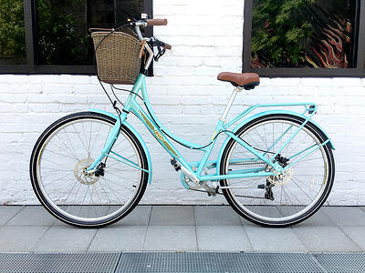 bright blue bike with a basket