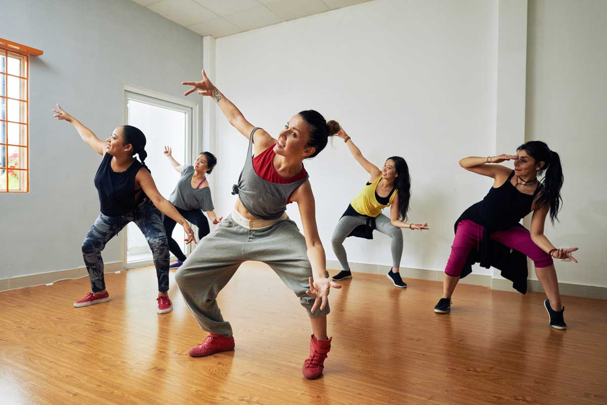 five people doing hiphop in dance class