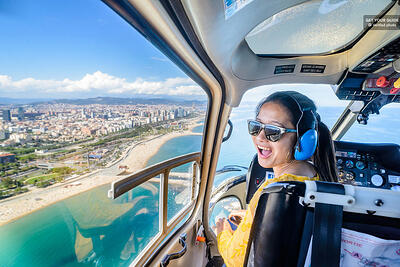 girl in a helicopter looking over the beach