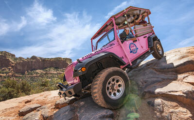 pink jeep on a rock in sedona